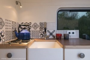 Kitchen with custom made belfast style sink
