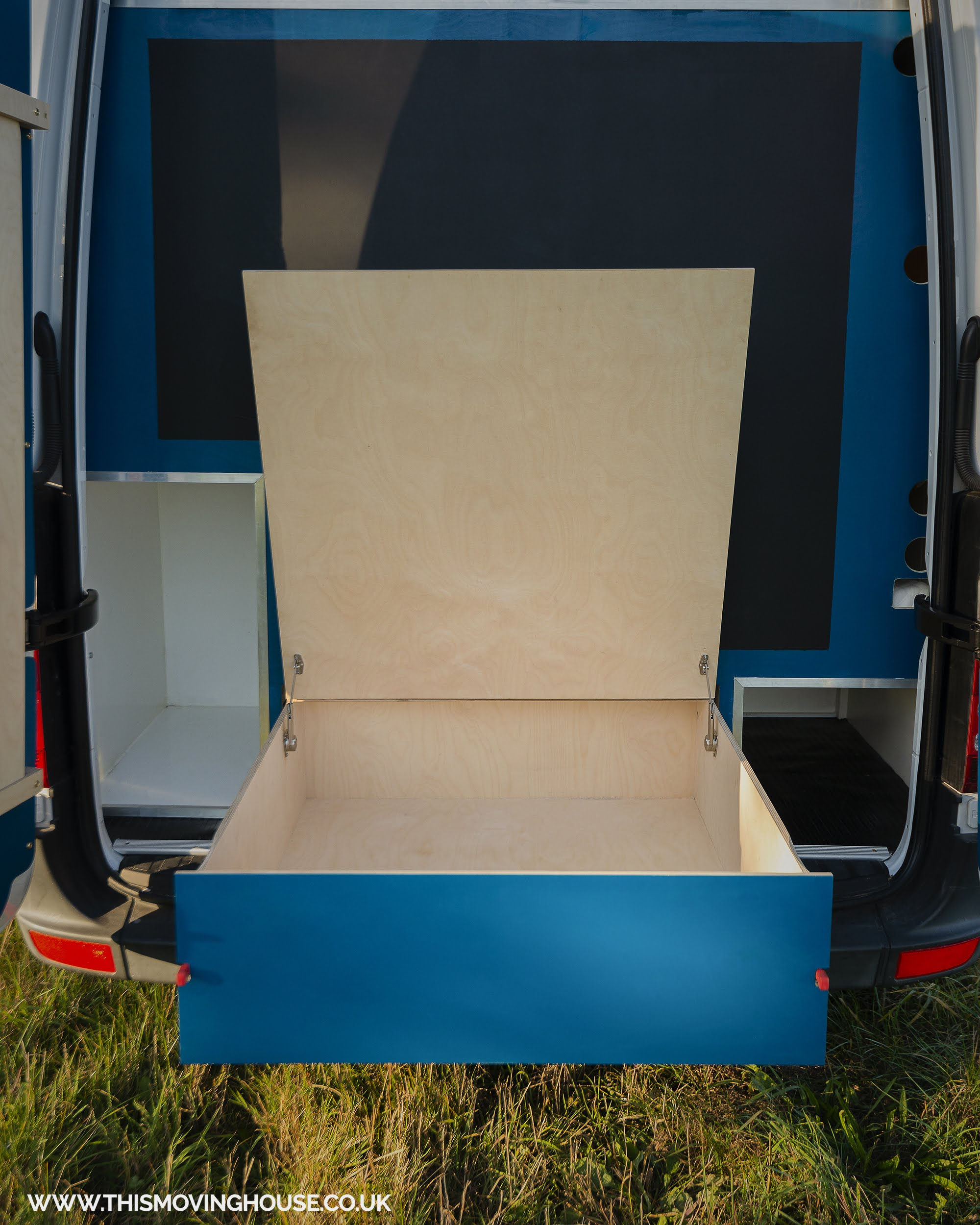 storage and dining area in a mercedes camper van