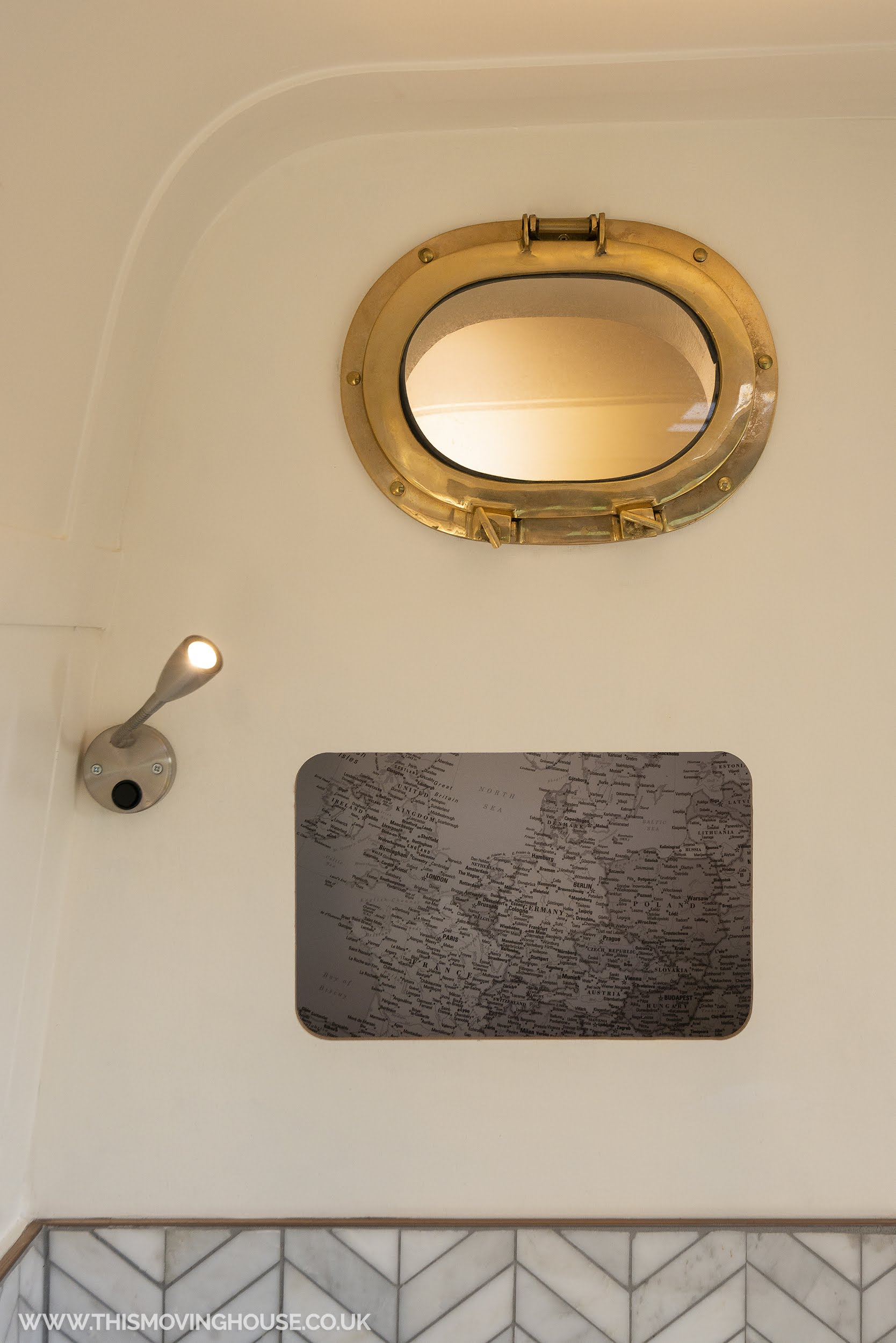 brass porthole lighting in camper van conversion
