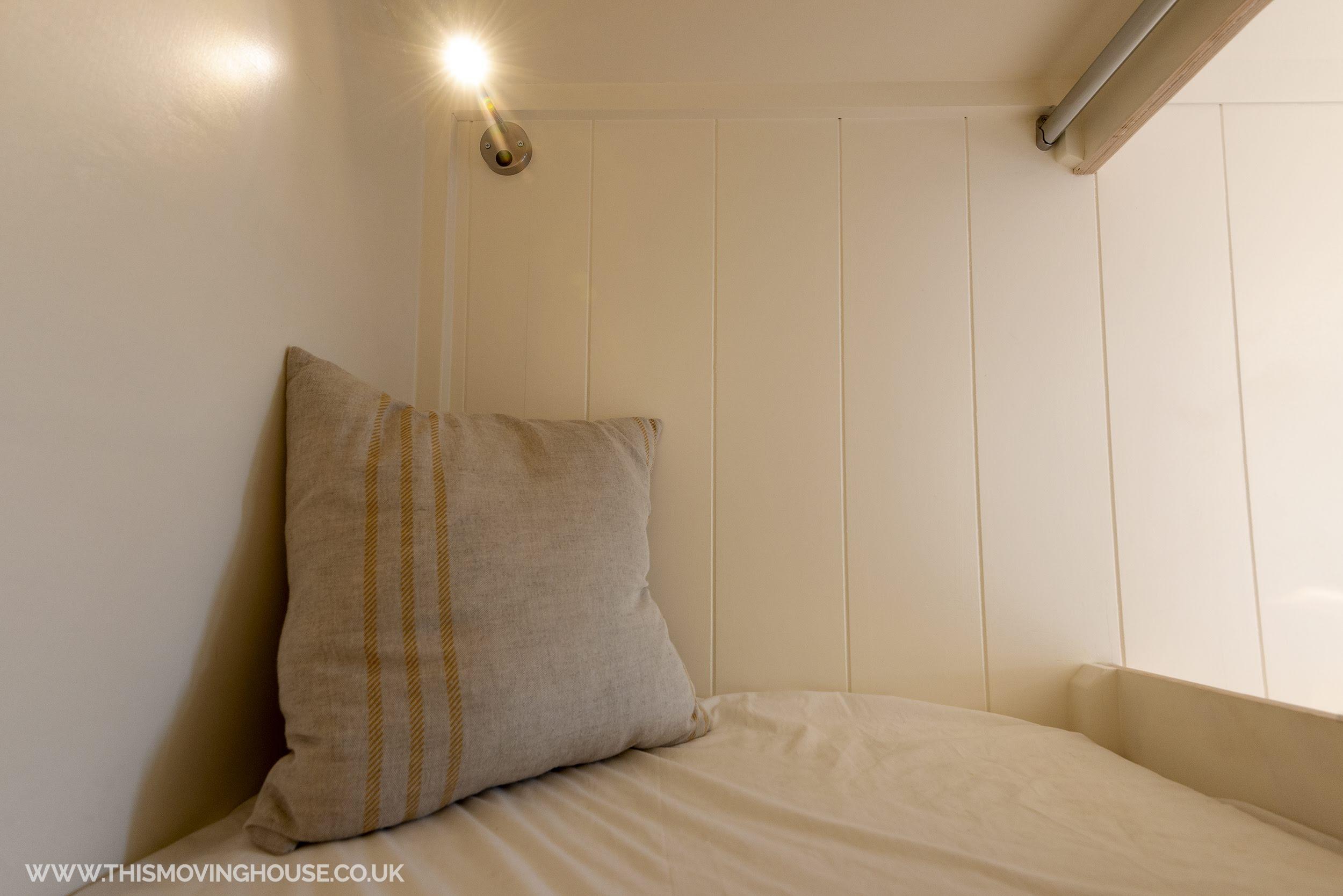 bunk bed capsule in a handmade camper van