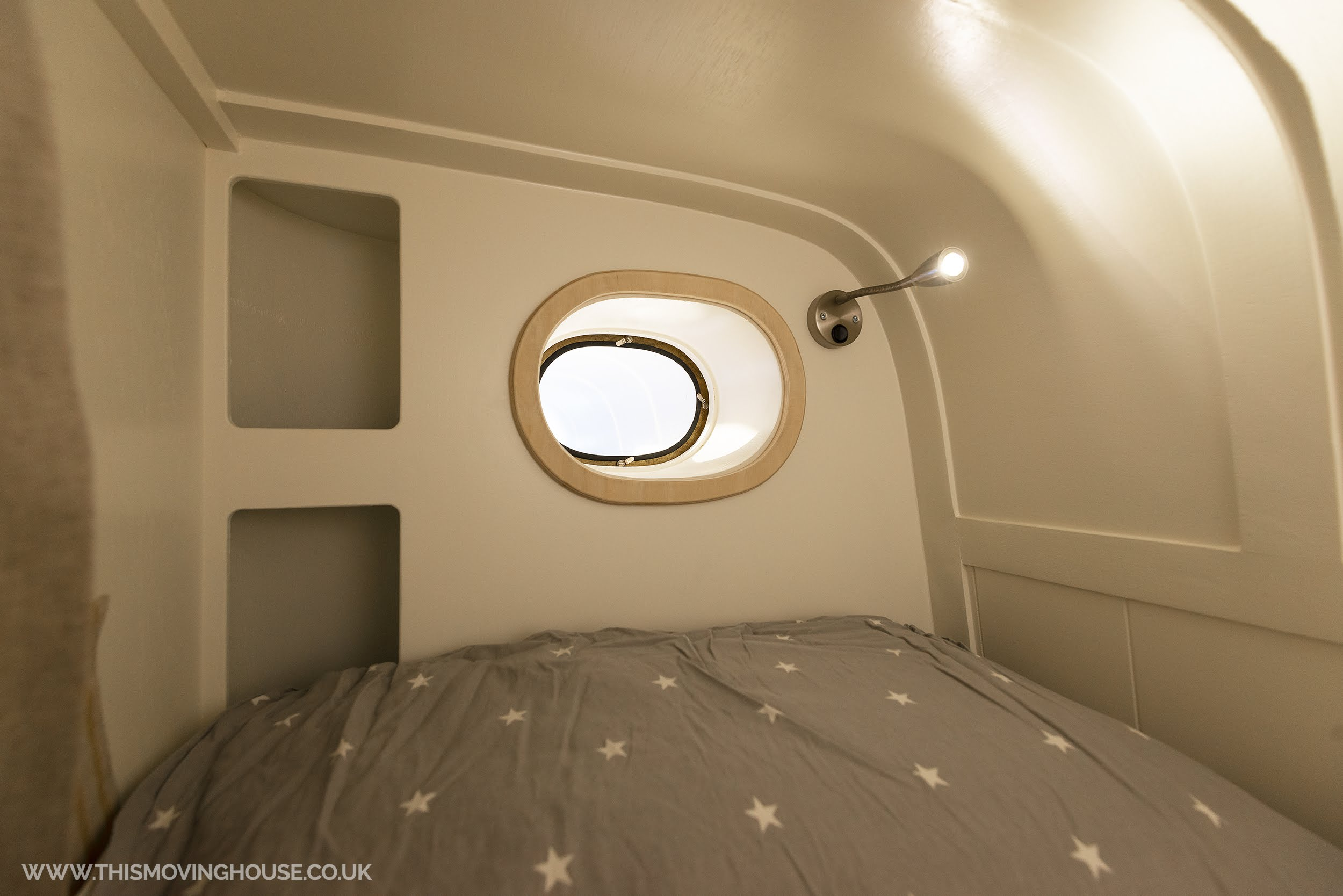 bunk bed in a bespoke camper van build