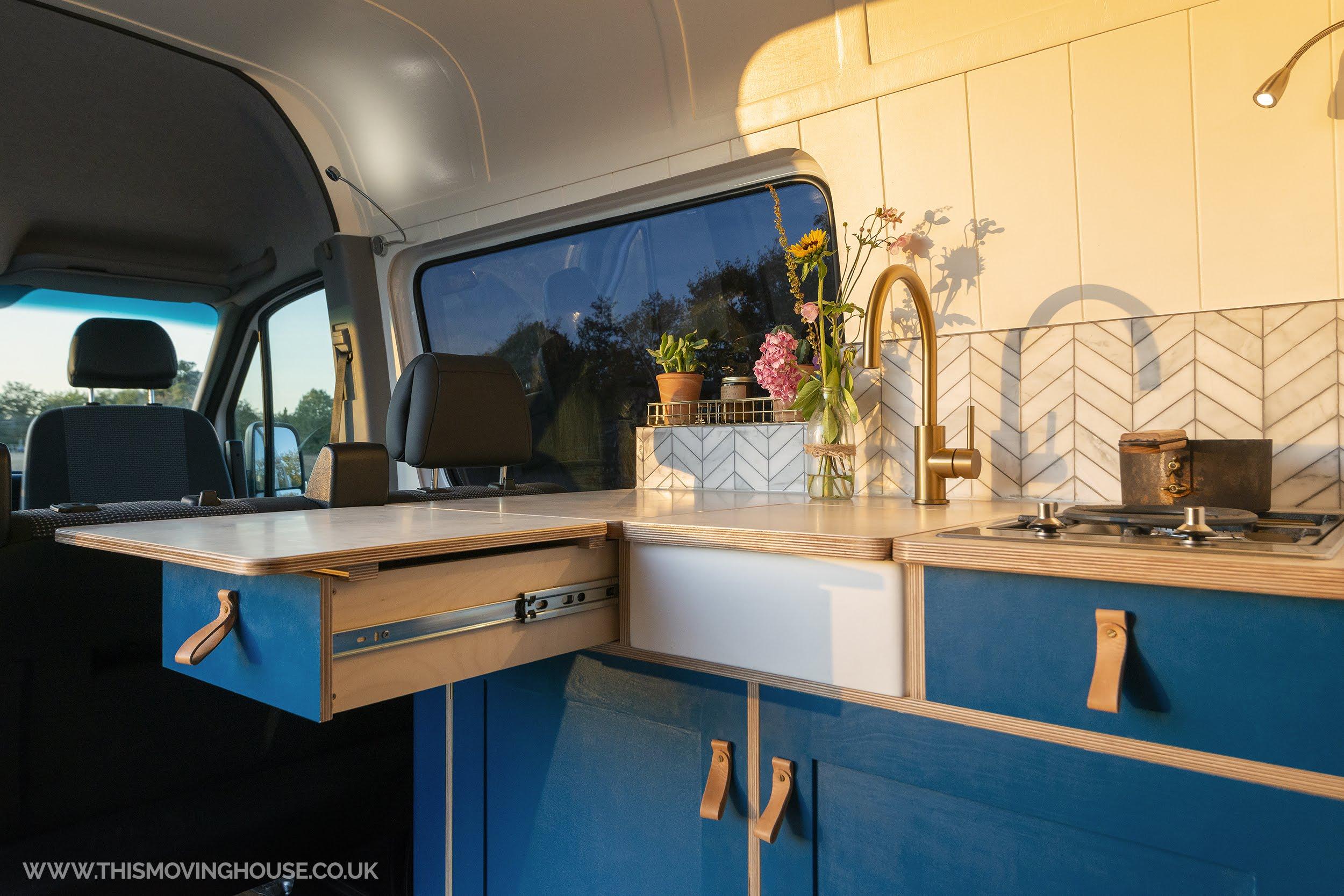hand made camper van with bespoke kitchen