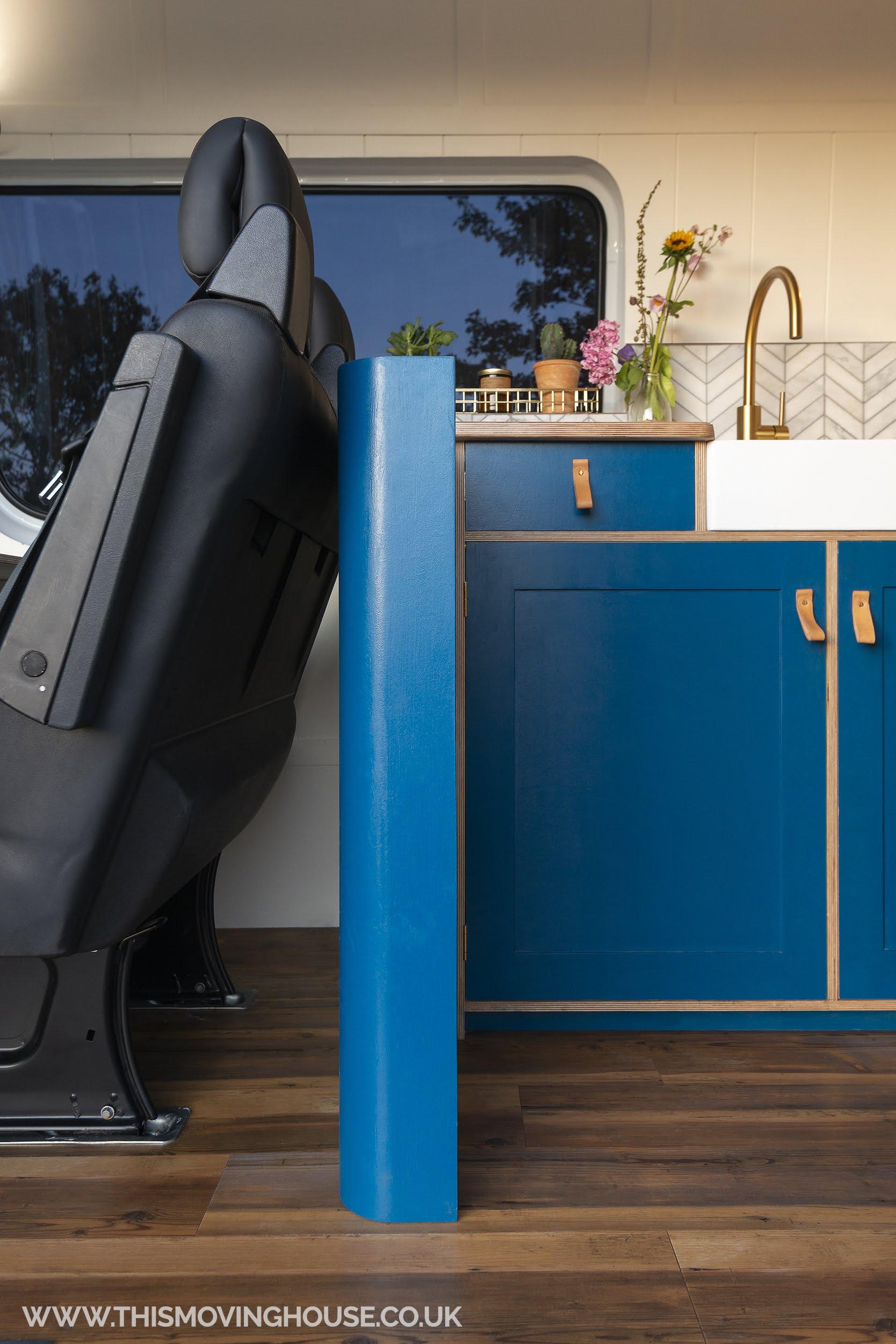 concealed storage in a bespoke camper van kitchen
