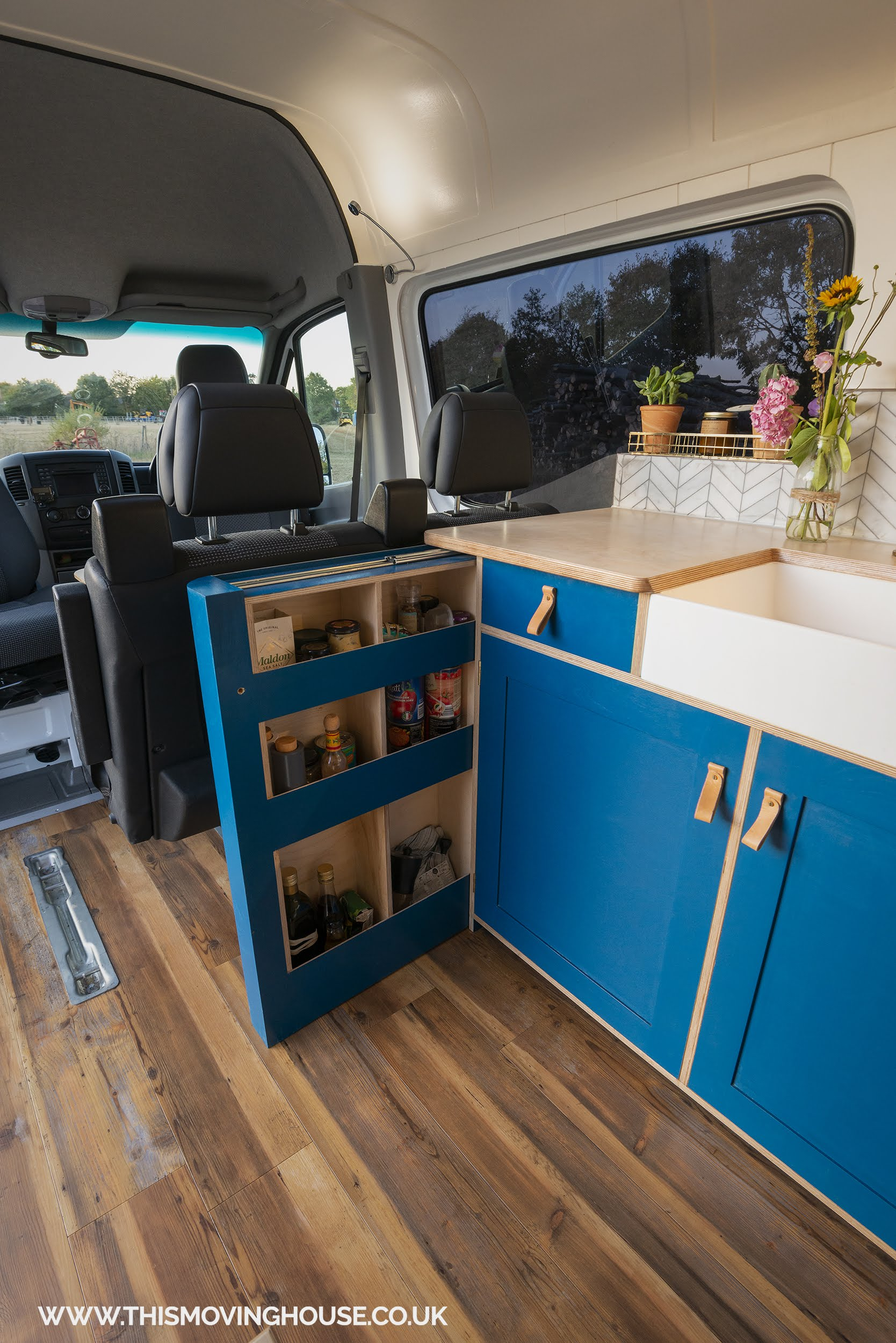 mini butler basin and storage in a bespoke camper kitchen