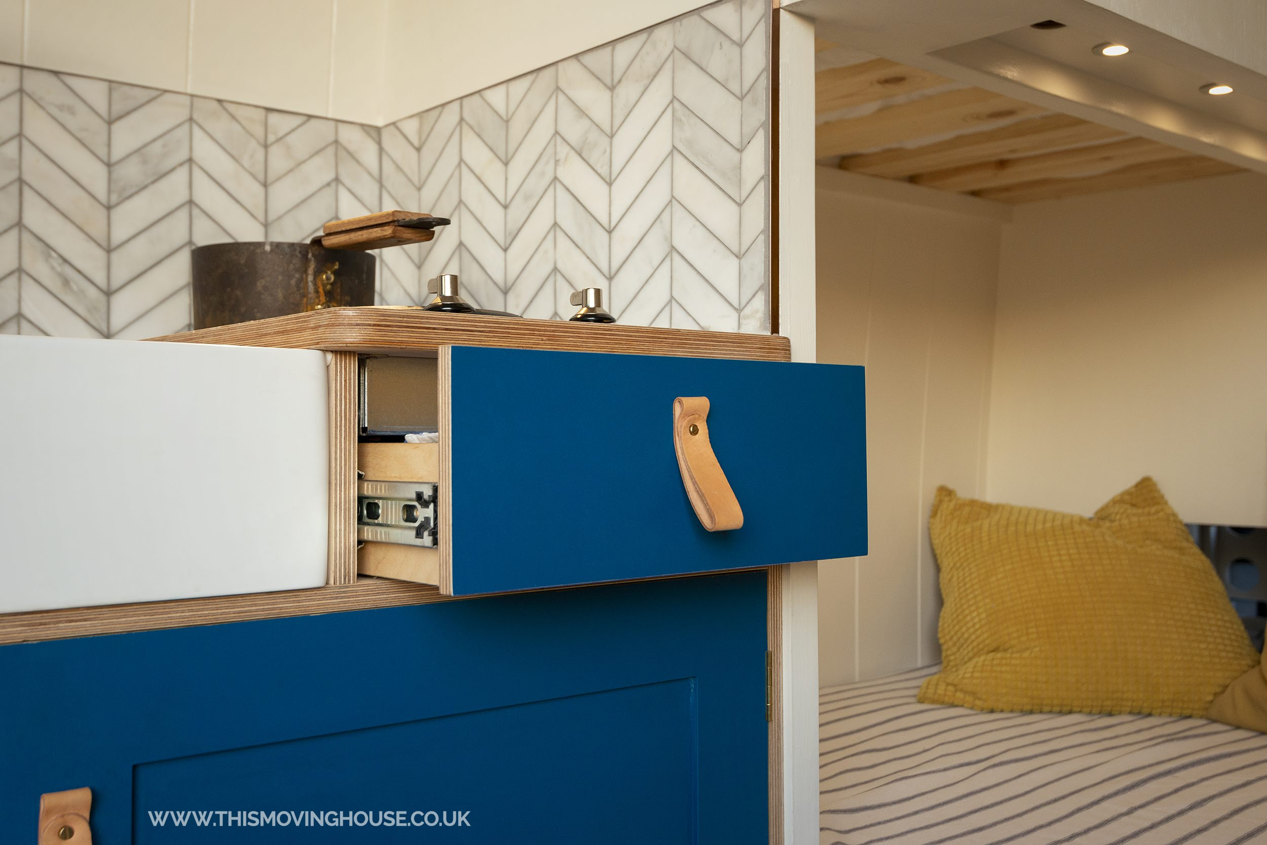 kitchen drawer with leather handle in a handmade  camper van kitchen