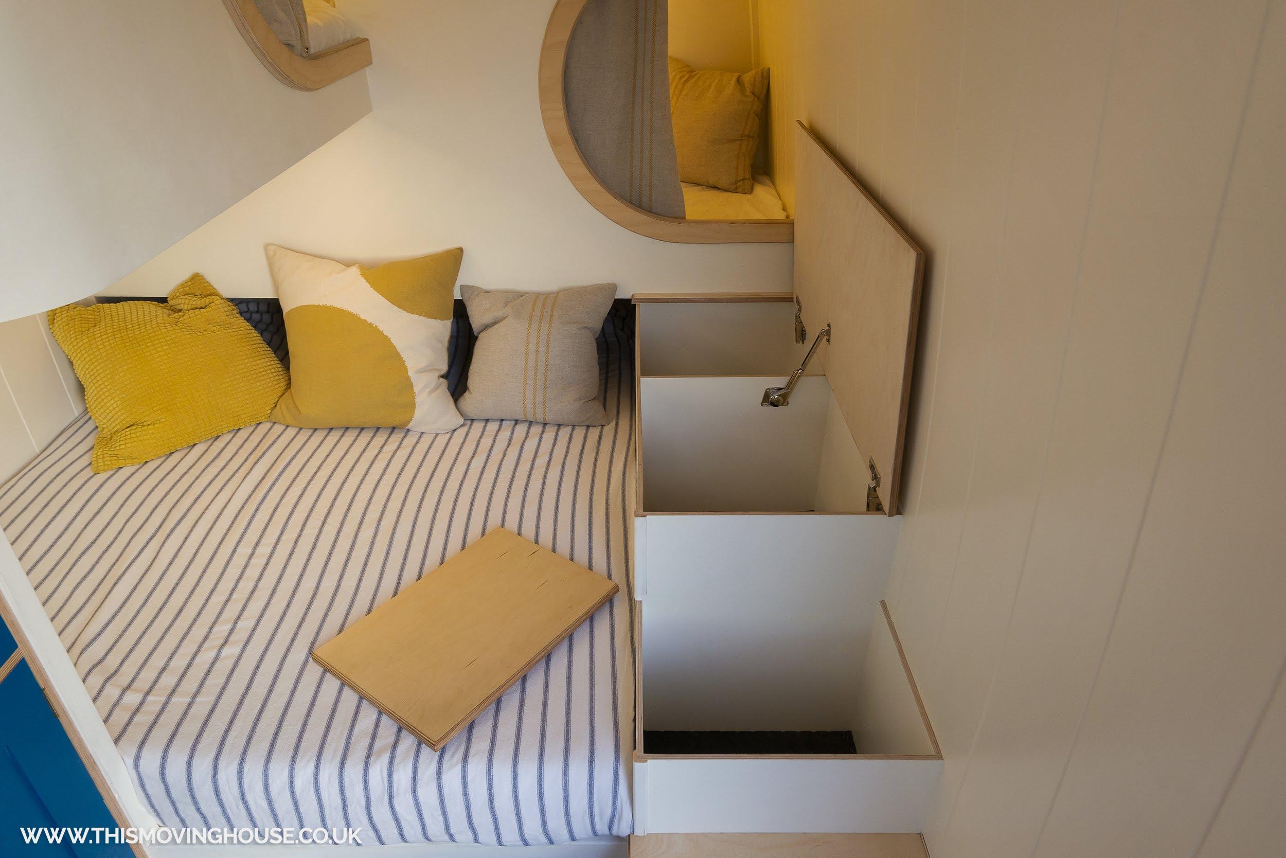 storage spaces in a handmade sprinter camper van