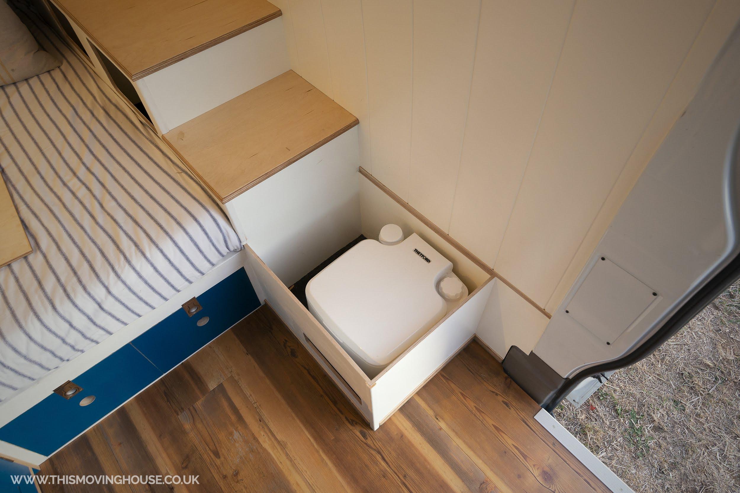 stowed porta potti in a mercedes camper van conversions