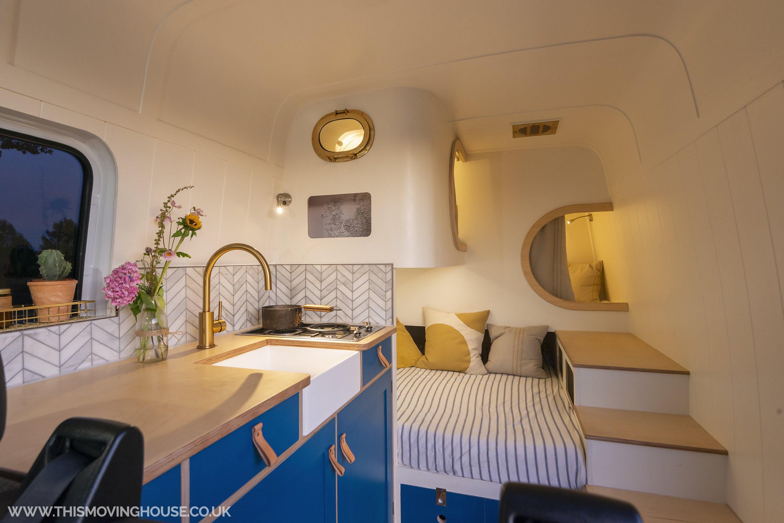 camper van interior with handmade ktichen