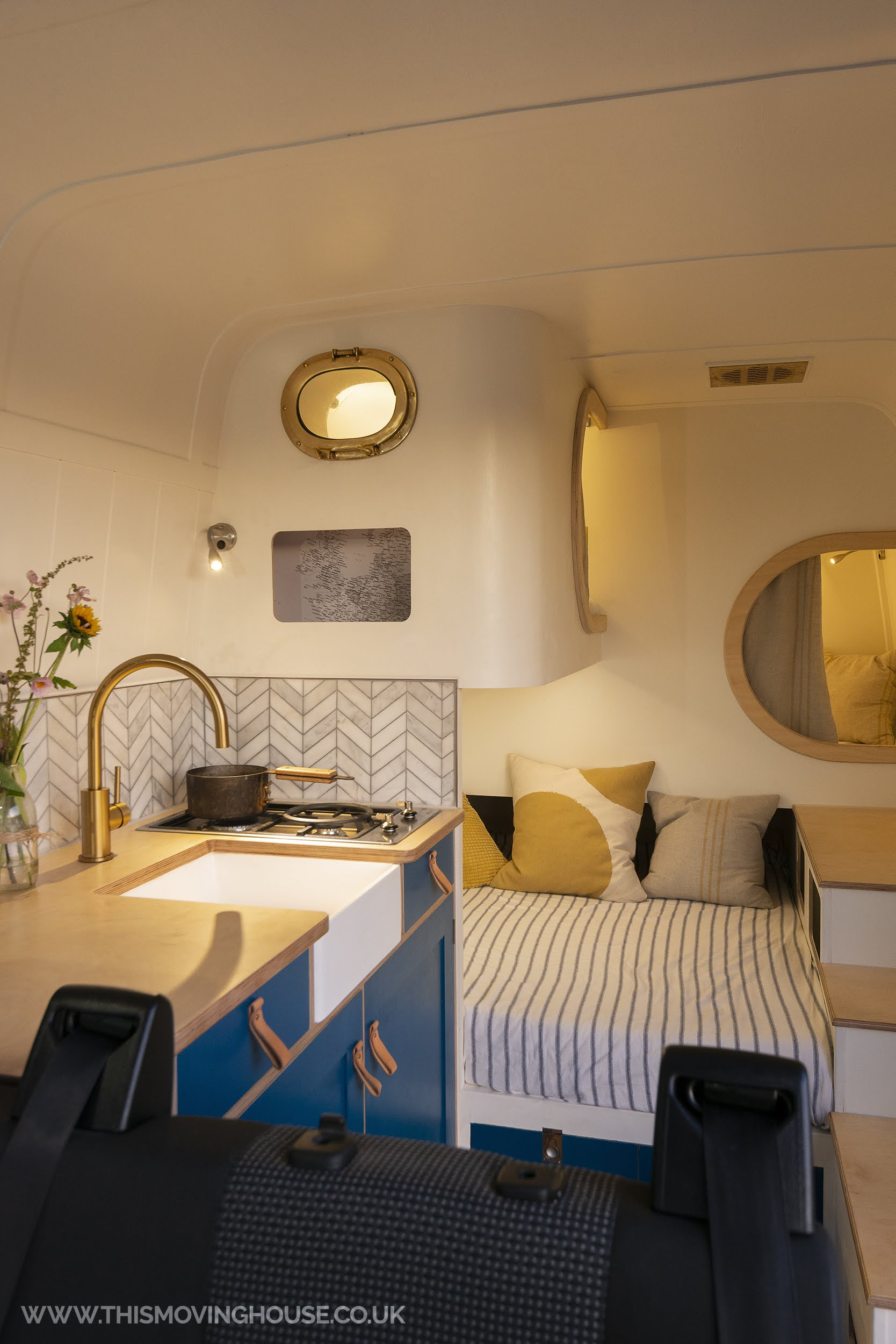Kitchen and sleeping area in a sprinter camper van