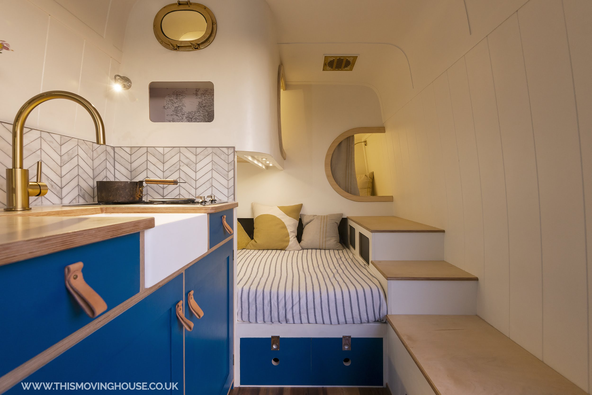 kitchen and bed layout in a family camper van