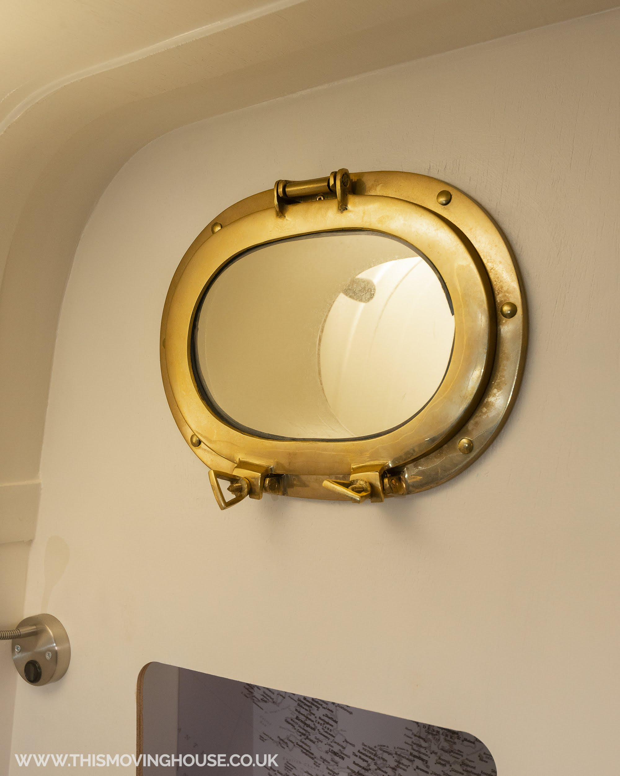 brass oval porthole in a family camper van